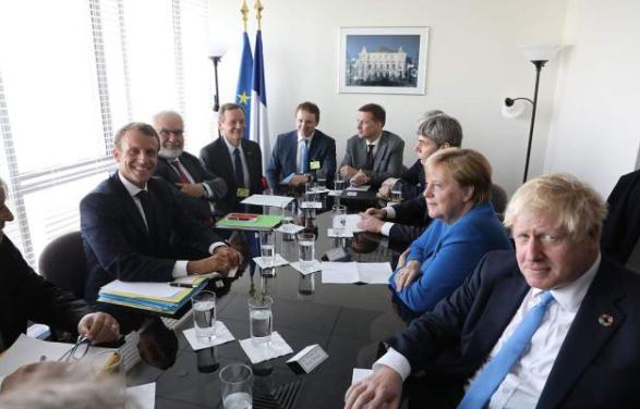 23日,英国、法国、德国三国指导人正在结合国总部接见会面(图源:路透社)