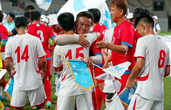 韩国男足时隔29年再抵平壤参赛 升国旗环节备受关注