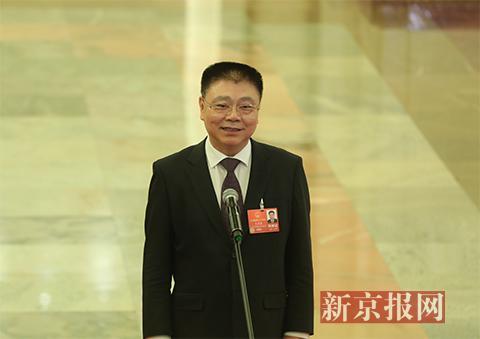 住建部部长王蒙徽接受采访。新京报记者 侯少卿 摄