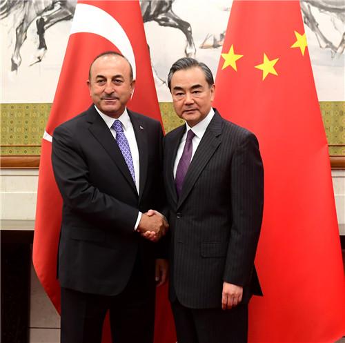 2018年6月15日,国务委员兼外交部长王毅在北京与到访的土耳其外长查武什奥卢举行会谈。