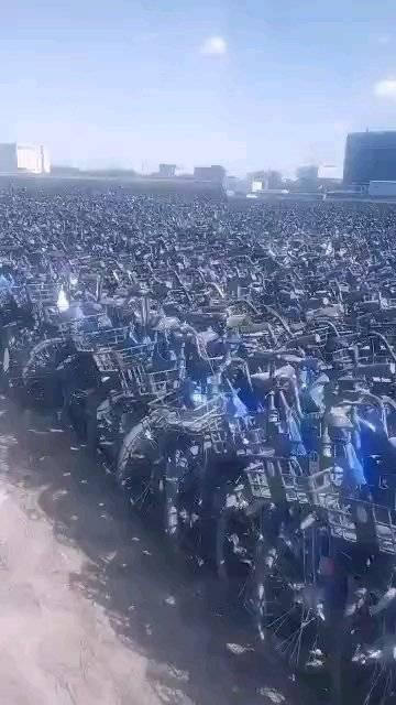 北京共享单车墓场,一眼望不到边,严重的资源浪费啊