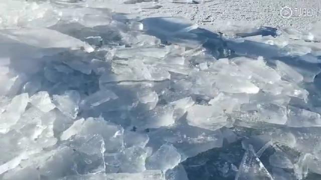 在最低气温-38℃的呼伦贝尔凿冰开泳道冬泳 是一种什么体验