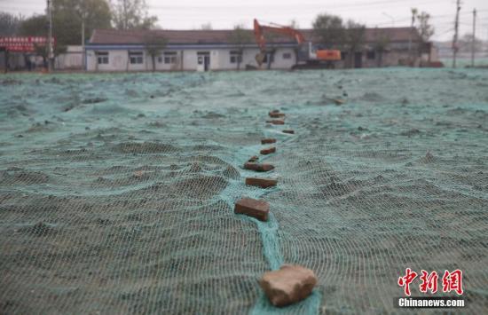 资料图:目前北京行政副中心的行政办公区所在地,通州区潞城镇郝家府村的拆迁工作已经完毕,核心区建设已全面展开。中新社记者 张浩 摄