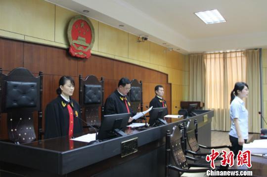 图为法官宣读判决 黄高森 摄