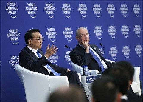 李克强在天津会见2016夏季达沃斯论坛企业家代表。新华社记者 庞兴雷 摄