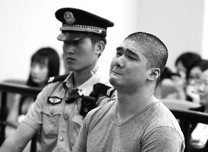 今天,法庭上的张某懊悔不已。北京晨报记者 郝笑天/摄