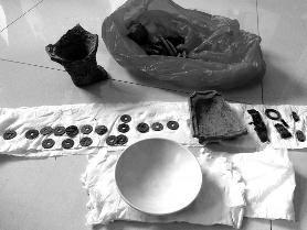 雨水冲刷致唐代古墓露出 4村民2天盗得27件文物