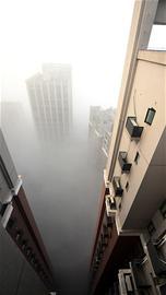 今冬最强雾霾围城 中度至重度污染可能持续到中旬