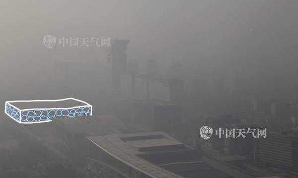 """昨天,北京水立方被霾""""吞没""""。关禺 摄"""