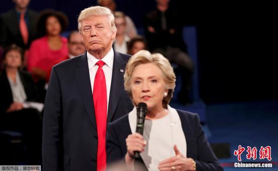 资料图:美国总统特朗普与美国前总统候选人希拉里。