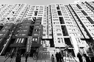 """""""位置最好""""自住房建工・动力港在2017年元旦到来之前交房入住。360户业主将在新居过新春。北京晨报记者 李木易/摄"""