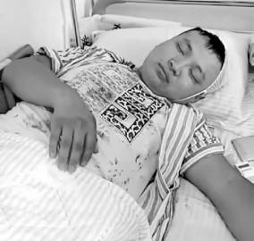受伤的业主还躺在医院 家属供图