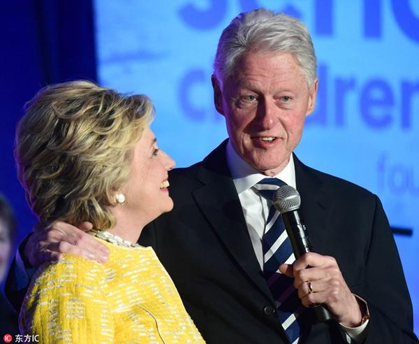 希拉里·克林顿在新书中称,丈夫比尔·克林顿是自己的骄傲。(图片来源:东方IC)