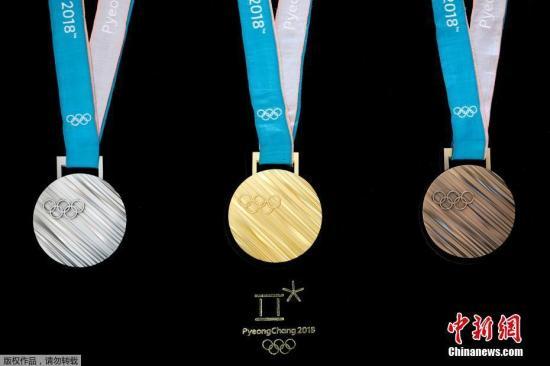 当地时间2017年9月21日,韩国首尔,2018平昌冬奥会奖牌设计正式揭晓,设计强调韩国之美,以象征民族精神的韩文图案为设计元素。