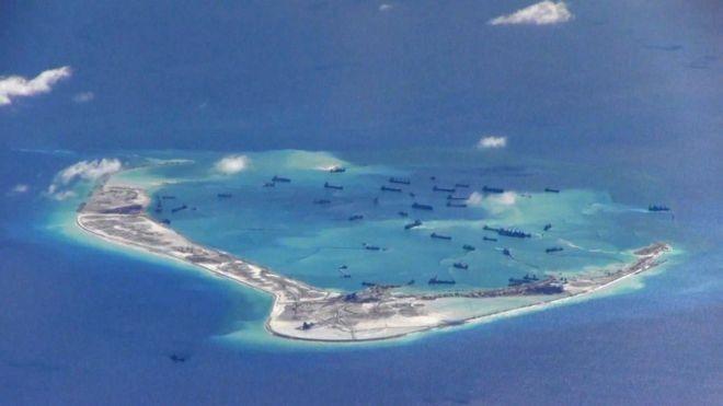 ▲资料图片:中国在美济礁等南海岛礁填海造地,并部署军事设施。(路透社)