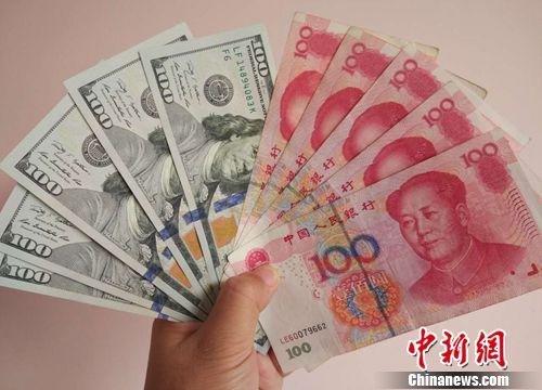 材料图:人口民币和美元。中新网记者 李金磊 摄