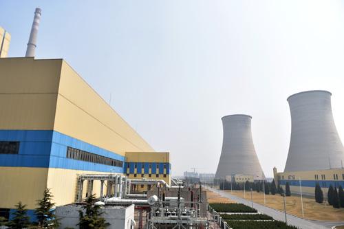 资料图片:2017年3月18日,北京最后一座大型燃煤电厂——华能北京热电厂燃煤机组停机,北京成为全国首个全部实施清洁能源发电的城市。新华社记者 张晨霖 摄