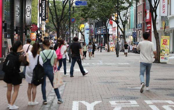 访韩游客不及以往。(韩联社)