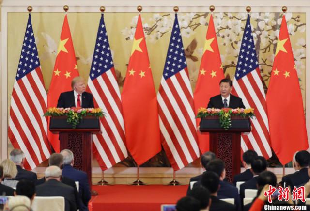 11月9日,国家主席习近平与美国总统特朗普在北京人民大会堂共同会见记者