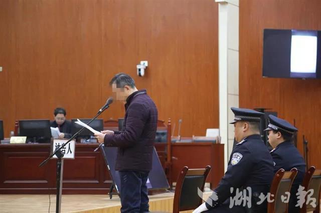 湖北孝感公安局原副局长受审 被控向黑老大索贿50万元