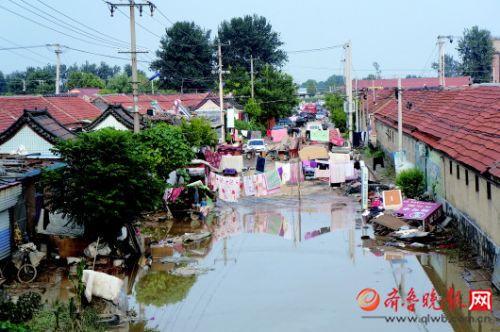 弥河山东寿光段多处决堤沿线村庄进水 村民获安置