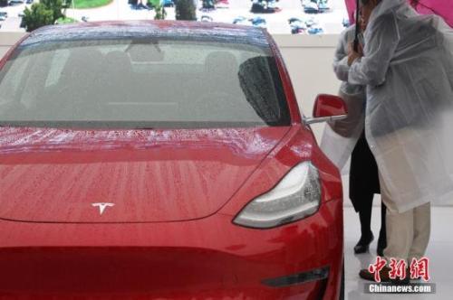 """特斯拉中国""""超级工厂""""一期年生产包括Model3?#35748;?#21015;车型。文/记者 张亨伟 郑莹莹 图/张亨伟"""