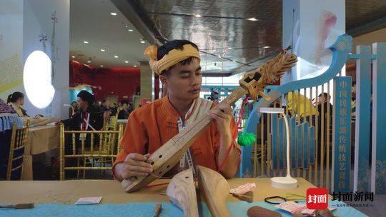 来非遗节,听95后传承人讲述傣族乐器玎三赛的魅力