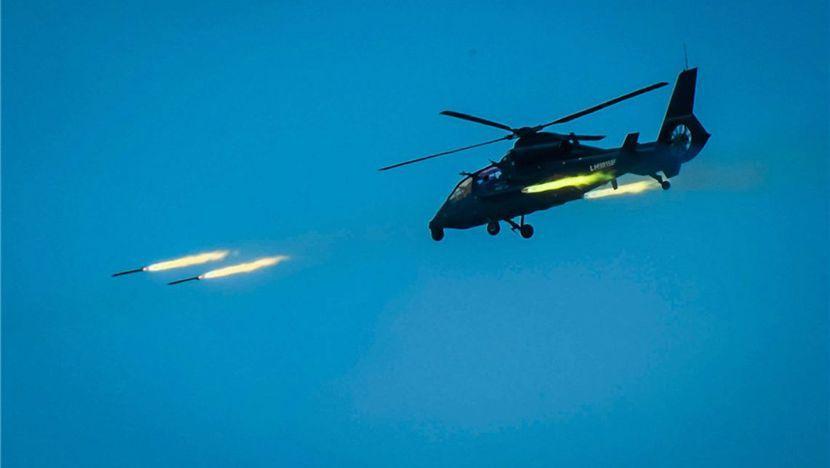 资料图:武直-19直升机开火瞬间。