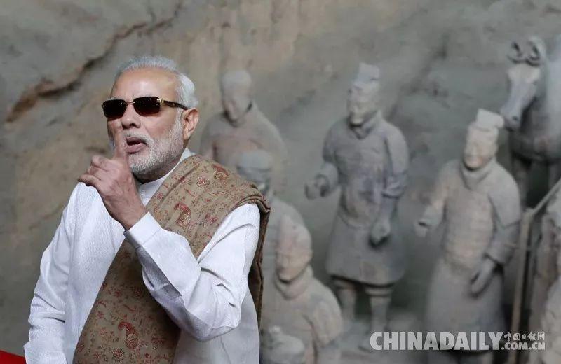 ▲资料图片:2018-06-24,正在中国进行正式访问的印度总理莫迪来到陕西西安市秦始皇帝陵博物院参观兵马俑。( 《中国日报》)