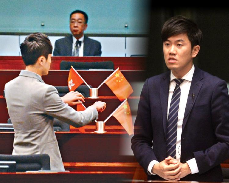 郑松泰于立法会议事厅,倒插国旗及区旗(图:港媒)