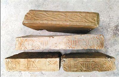 西乡发现汉墓遗存物 工人施工时挖出古砖古钱