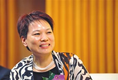 2010年9月,新光控股集团董事长周晓光。资料图片/视觉中国