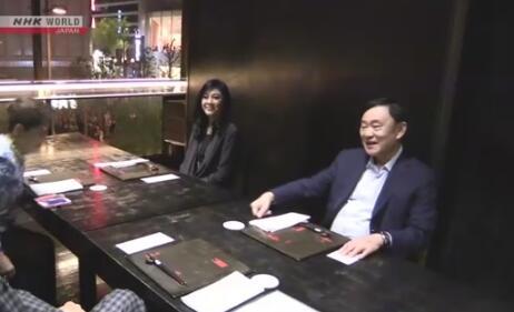 英拉及他信被指在日本接受采访。(图源:NHK)