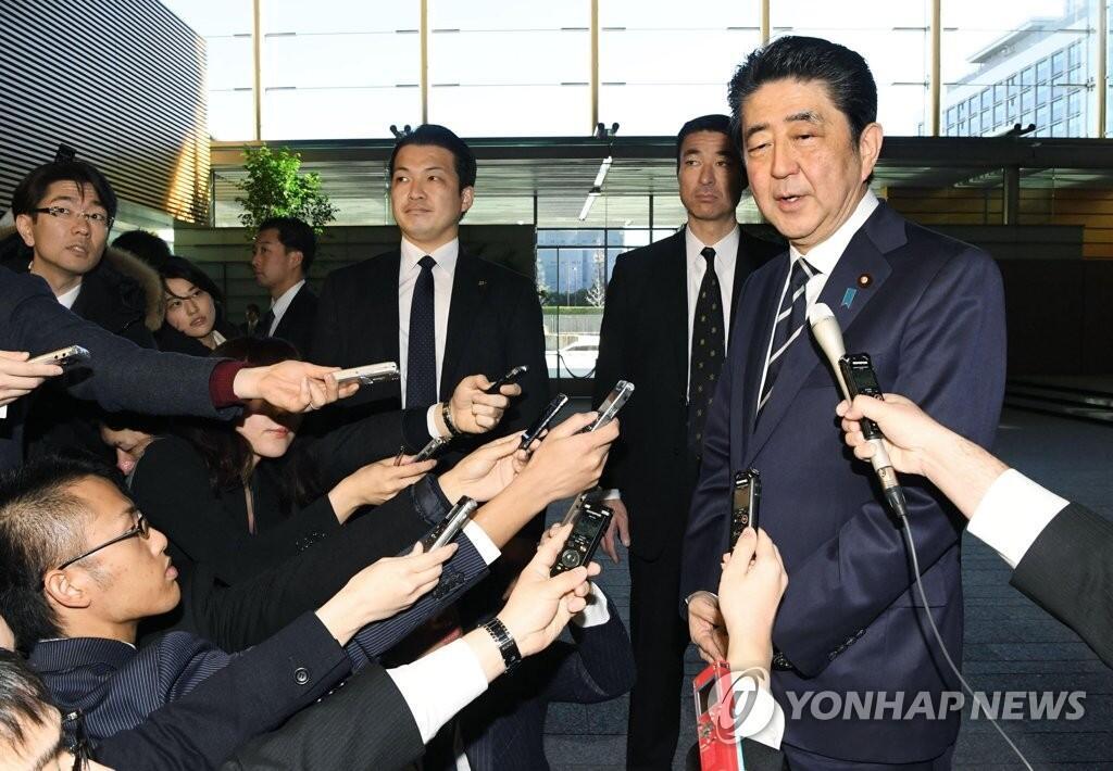 安倍决定为出席平昌冬奥会访韩 韩总统府