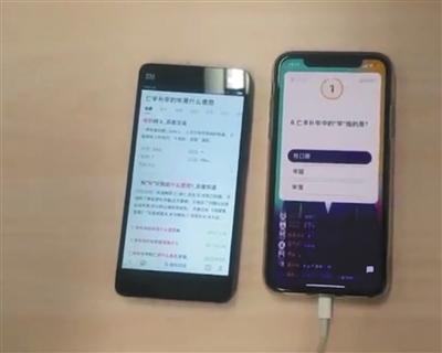 网上标价5元的教学视频显示,一部手机登录平台答题,另一部手机使用语音搜索功能找答案。