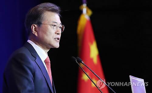 图注:韩国总统文在寅13日在旅华韩侨恳谈会上谈话