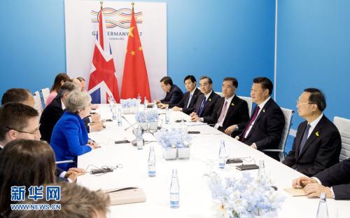 资料图:2017年7月7日,中国国家主席习近平在汉堡会见英国首相特雷莎·梅。 新华社记者 李学仁 摄 图片来源:新华网