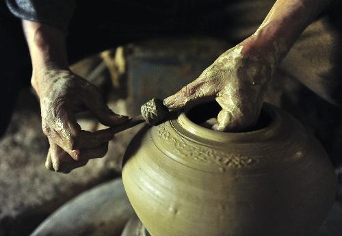 穿孔茶壶绳的编法图解