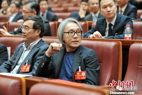周星驰出席广东省政协闭幕大会(图/中新社)