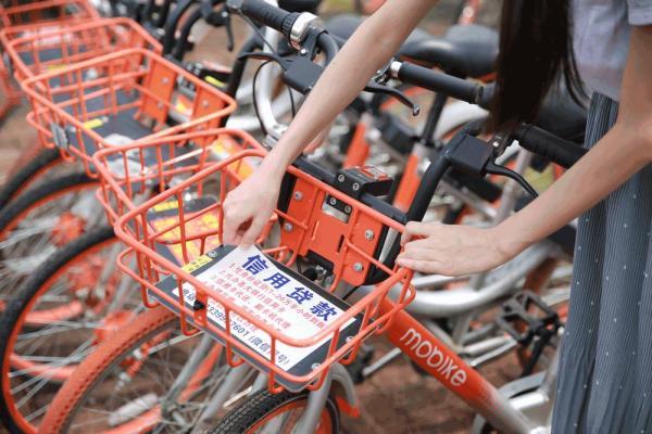 摩拜首次起诉广告公司:北上广深等城市大量单车被贴