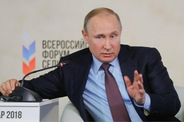 俄罗斯总统普京民调极高,外界认为其将轻而易举赢得大选。(图片来源:英国《每日邮报》)