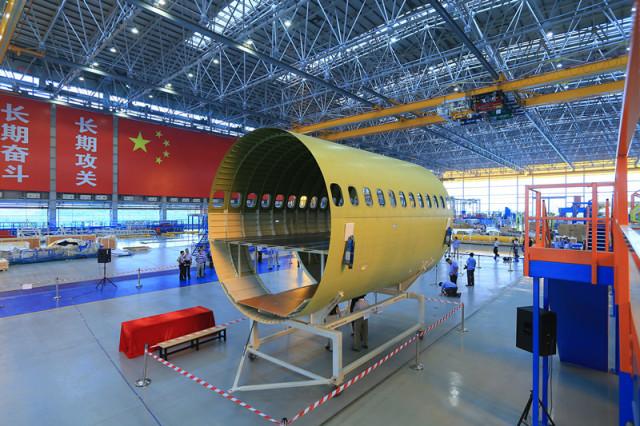 2014年9月19日,c919飞机机身部段开始对接   大型民用飞机制造被称为