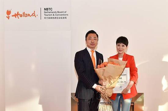 荷兰国家旅游会议促进局亚洲区总监、中国区首席代表杨宇先生与荷兰旅游中国区大使海清女士