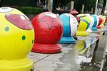 """石礅变""""大头娃娃"""" 艺术涂鸦让城市温暖起来"""