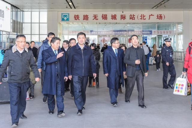 汪泉检查春运 节日市场供应及安全生产