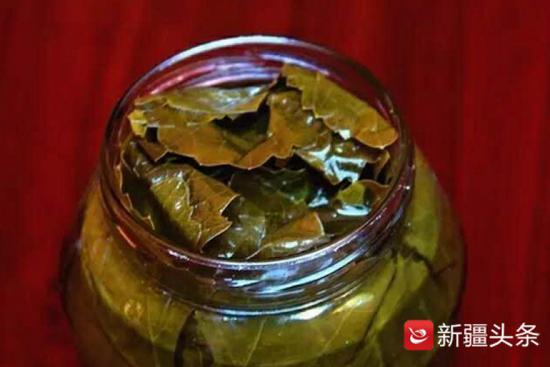 新疆黄金叶子食品有限公司出口的葡萄叶加工的罐头。
