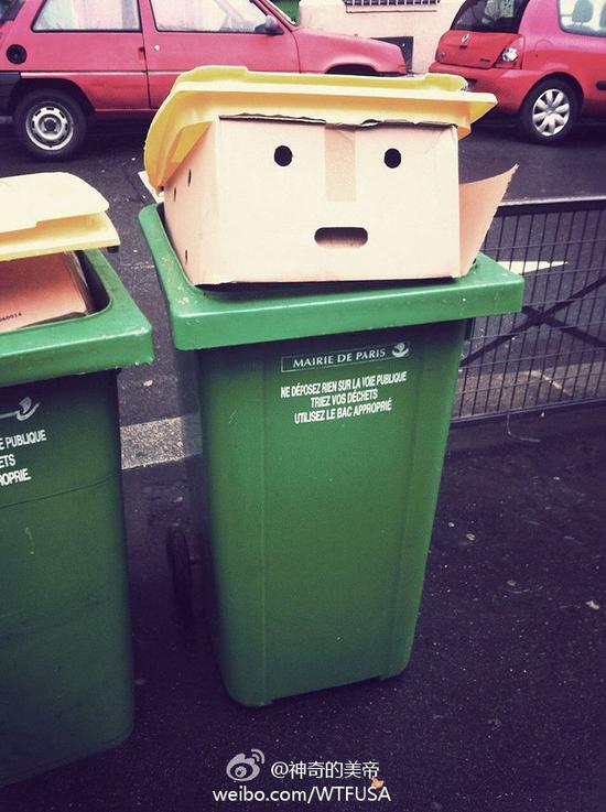 有人在垃圾桶上发现一个纸盒子