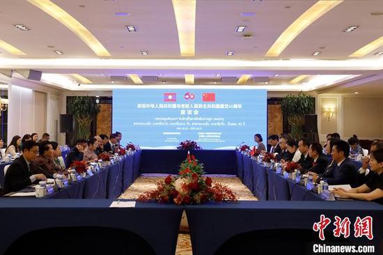 4月26日,云南省昆明市举行庆祝中老建交60周年座谈会。中新社记者 李嘉娴 摄