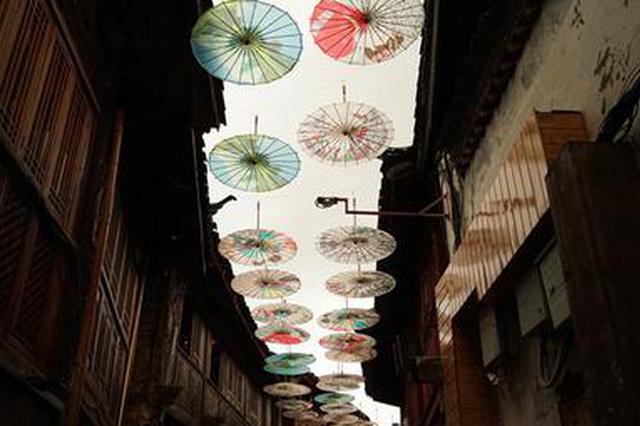 旅游丨来丽江古城邂逅漫天油纸伞 浪漫唯美