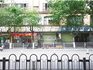 吴井路店铺旧招牌已被拆下